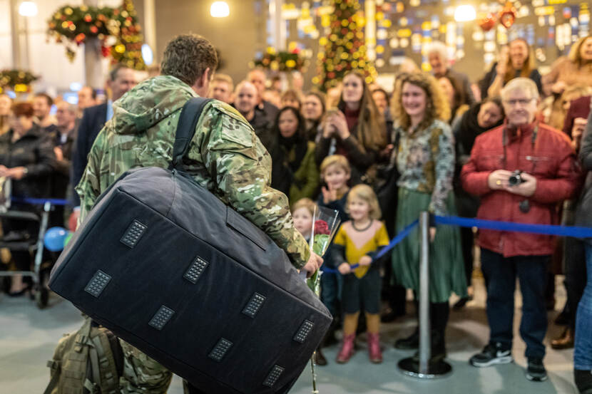 A returning soldier from the the last Air Task Force Middle East arrives at Airbase Eindhoven.