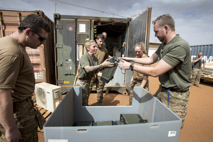 Dutch military personnel from the redeployment team are packing up stuff for transportation back to the Nedetherlands.