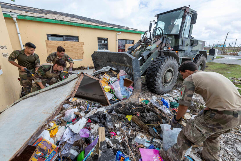 Dutch military personnel helps to clean up the devastation caused by Hurricane Dorian.