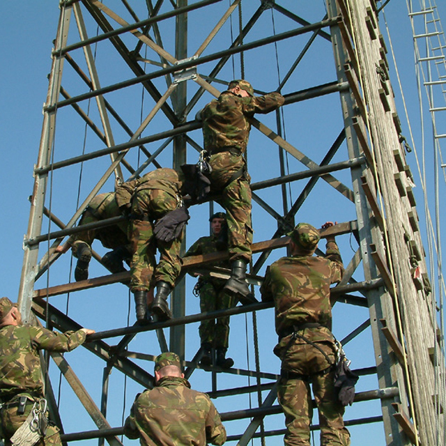 Soldiers on a climbing tower during training.